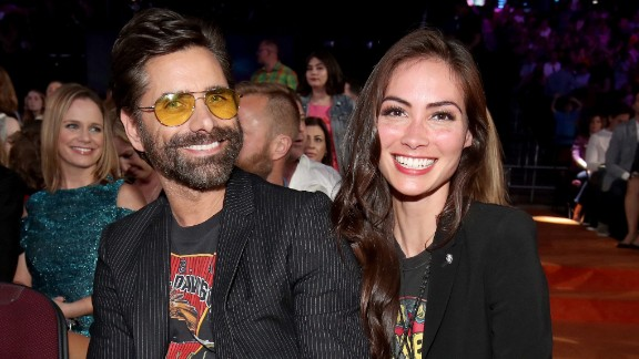 Actor John Stamos and Caitlin McHugh at Nickelodeon's 2017 Kids' Choice Awards on March 11, 2017, in Los Angeles, California.