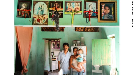 João Henrique, who has microcephaly, with his grandmother and grandfather in São José da Tapera. His mother, Robéria, died two months after giving birth.