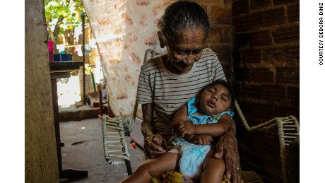 "Grandmothers are often called upon to help with child care. Maria de Rosilene is the primary caregiver for her grandson, Eduardo, who cannot walk. ""It's hard for Maria because he is getting heavy,"" said Diniz."