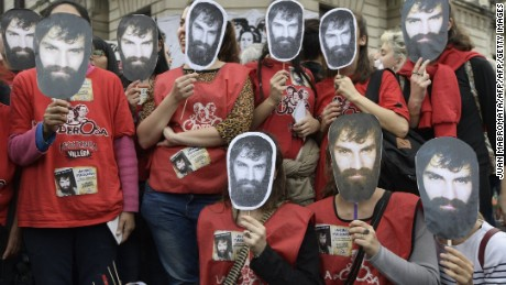 Activists cover their faces with portraits of Santiago Maldonado --disappeared on August 1st during a Mapuche protest in Chubut province-- during a demonstration called by human rights associations asking for his whereabouts, at Plaza de Mayo square in Buenos Aires on September 1, 2017.  Maldonado disappeared last August 1 when the Gendarmerie dispersed a Mapuche protest in the Pu Lof community, Resistencia, Cushamen Department, some 1850 km southwest of Buenos Aires. He is said to have last been seen being put into a military police vehicle by officers who broke up a demonstration in the southern province of Chubut.  / AFP PHOTO / JUAN MABROMATA        (Photo credit should read JUAN MABROMATA/AFP/Getty Images)