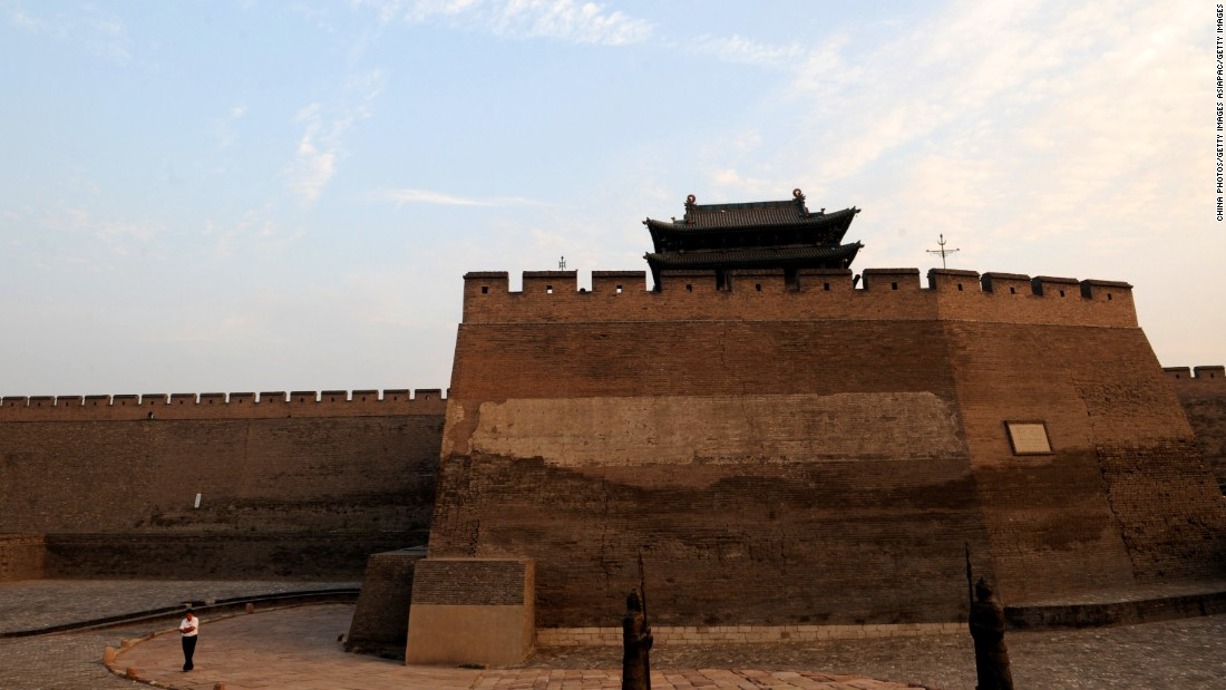The Pingyao ancient city wall was built to defend the city and is surrounded by a moat designed to provide further protection for the city's inhabitants.