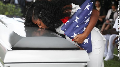 HOLLYWOOD, FL - OCTOBER 21:  Myeshia Johnson kisses the casket of her husband U.S. Army Sgt. La David Johnson during his burial service at the Memorial Gardens East cemetery on October 21, 2017 in Hollywood, Florida. Sgt. Johnson and three other American soldiers were killed in an ambush in Niger on Oct. 4.  (Photo by Joe Raedle/Getty Images)