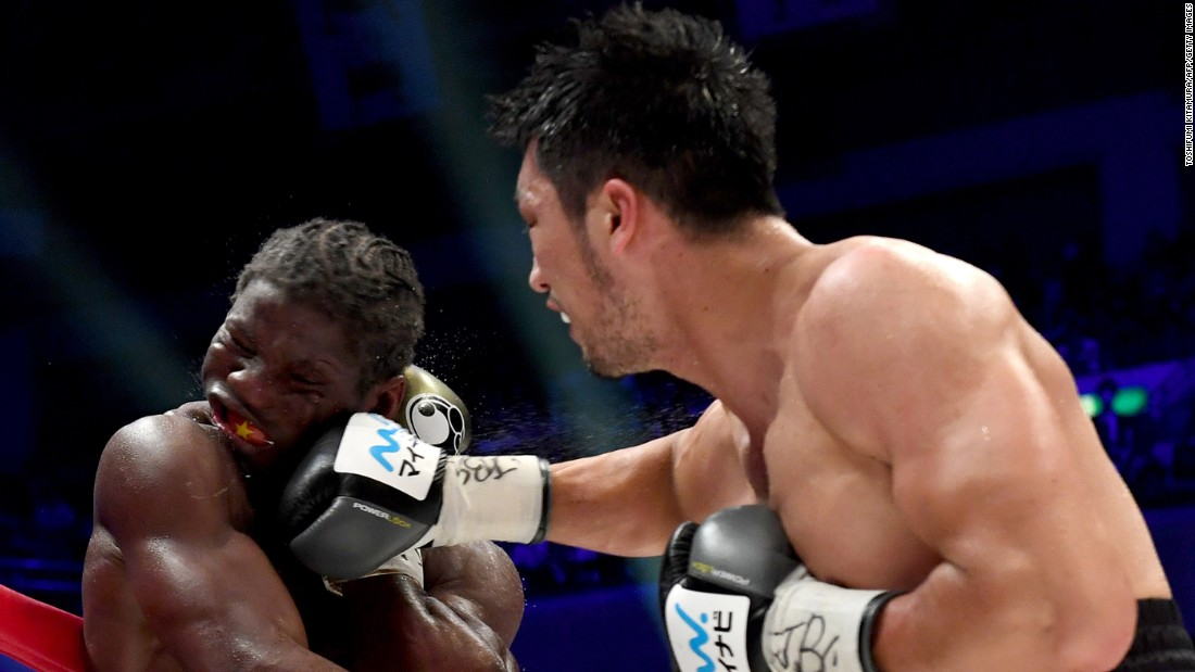 Ryota Murata punches Hassan N'Dam during their middleweight title fight in Tokyo on Sunday, October 22. Murata won the WBA belt when the fight was stopped after the seventh round.