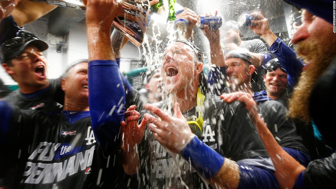 Chase Utley is doused in the clubhouse as the Los Angeles Dodgers celebrate their National League title on Thursday, October 19. The Dodgers defeated the Chicago Cubs in five games to advance to their first World Series since 1988.