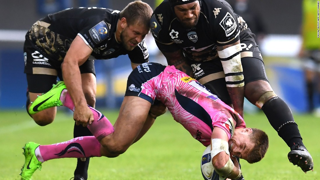 Exeter's Henry Slade is tackled by Montpellier's Francois Steyn, left, and Nemani Nadolo during a Champions Cup rugby match in Montpellier, France, on Sunday, October 22.