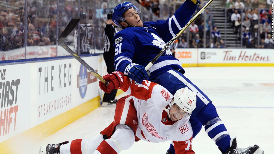 Detroit's Dylan Larkin, bottom, collides with Toronto's Jake Gardiner during an NHL game in Toronto on Wednesday, October 18.