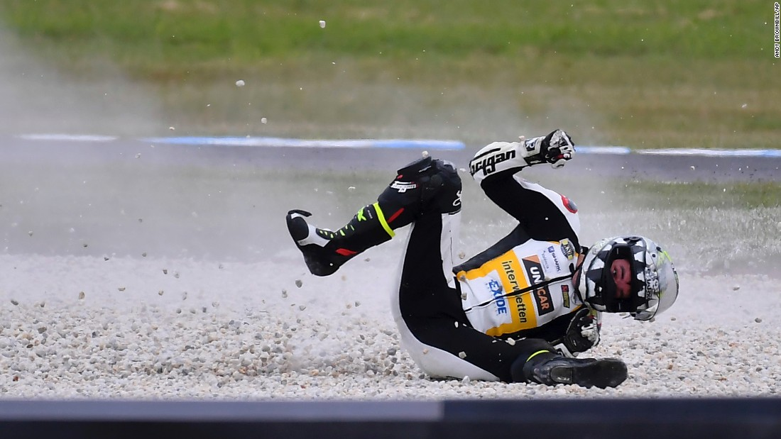 Iker Lecuona slides through gravel Saturday, October 21, after falling from his motorcycle during a practice session for the Moto2 race in Australia. He raced the next day and finished in 20th place.