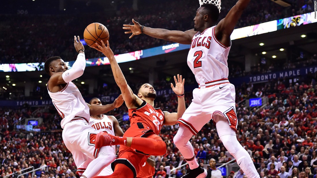Toronto guard Fred VanVleet drives for a shot between Chicago guards David Nwaba, left, and Jerian Grant during an NBA game on Thursday, October 19.