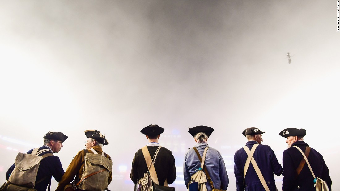 "Members of the End Zone Militia, a group of Revolutionary War re-enactors, watch the New England Patriots play the Atlanta Falcons in a foggy Super Bowl rematch on Sunday, October 22. <a href=""http://www.cnn.com/2017/10/16/sport/gallery/what-a-shot-sports-1017/index.html"" target=""_blank"">See 23 amazing sports photos from last week</a>"