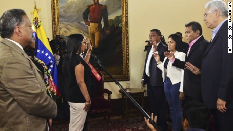 "A handout picture released by Constituent Assembly's Office shows Venezuelan Constituent Assembly President Delcy Rodriguez (L) swears in four opposition governors in Caracas on October 23 , 2017. Four opposition governors elected October 15 in Venezuela were sworn in before the Constituent Assembly, after initially refusing to take an oath before it. / AFP PHOTO / CONSTITUENT ASSEMBLY'S OFFICE / HO / RESTRICTED TO EDITORIAL USE - MANDATORY CREDIT ""AFP PHOTO / CONSTITUENT ASSEMBLY'S OFFICE "" - NO MARKETING - NO ADVERTISING CAMPAIGNS - DISTRIBUTED AS A SERVICE TO CLIENTS  HO/AFP/Getty Images"