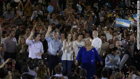 Argentine President Mauricio Macri (2-L) waves next to Buenos Aires Governor Maria Eugenia Vidal (C) Cambiemos party legislator candidate for Buenos Aires city Elisa Carrio (2-R), and Argentine Vice-President Gabriela Michetti in Buenos Aires on October 17, 2017 during the closure campaign of the ruling party candidates for Buenos Aires city ahead of the October 22 legislative election. / AFP PHOTO / JUAN MABROMATA        (Photo credit should read JUAN MABROMATA/AFP/Getty Images)