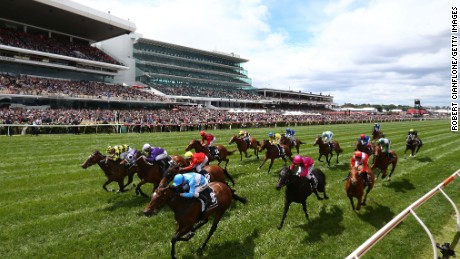 More than 100,000 fans pack into Flemington on Melbourne Cup day