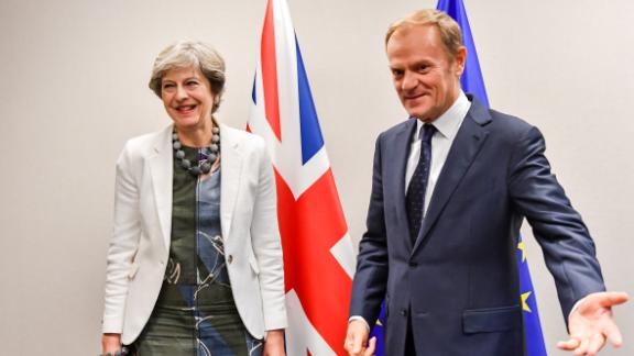 British Prime Minister Theresa May (L) is welcomed by European Council President Donald Tusk for a bilateral meeting during an EU summit in Brussels on October 20, 2017.  The EU is expected to say that they will start internal preparatory work on a post-Brexit transition period and a future trade deal with Britain. / AFP PHOTO / POOL / Geert Vanden Wijngaert        (Photo credit should read GEERT VANDEN WIJNGAERT/AFP/Getty Images)