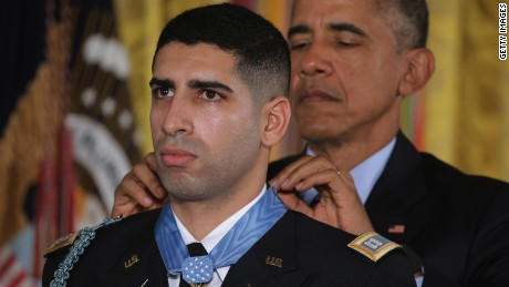 WASHINGTON, DC - NOVEMBER 12:  U.S. President Barack Obama (R) presents the Medal of Honor to retired Army Captain Florent Groberg during an East Room ceremony at the White House November 12, 2015 in Washington, DC. Born in France and a naturalized U.S. citizen, Groberg received the Medal of Honor for tackling a suicide bomber and saving fellow soldiers' lives in Afghanistan's Kunar Province in August 2012. He was also badly injured in the attack, which killed four people.  (Photo by Chip Somodevilla/Getty Images)