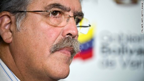 "Argentine Minister of Federal Planning, Julio de Vido, is seen during a conference with members of the Venezuelan government offering aid from his country in response to Venezuela's current electricity crisis in Caracas on February 6, 2010. As Venezuelan opposition voiced their criticisms in response to the arrival of numerous foreign representatives aimed at solving the electricity crisis, de Vido stated that Argentina sought to ""return the solidarity"" that Venezuela offered Argentina in 2004 when it experienced a similar problem.  AFP PHOTO/STR (Photo credit should read STR/AFP/Getty Images)"
