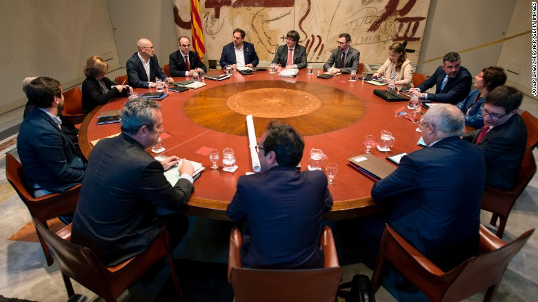 Catalan regional President Carles Puigdemont (center) chairs a regional goverment meeting in Barcelona on Tuesday.