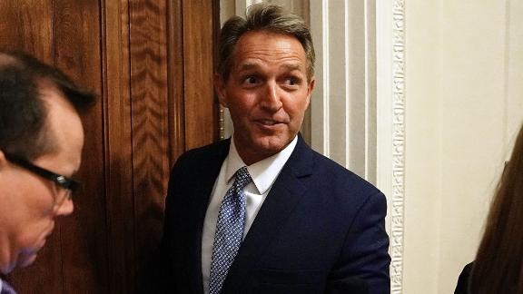 Sen. Jeff Flake (R-AZ) talks briefly with reporters after leaving the Senate Chamber at the U.S. Capitol October 24, 2017 in Washington, DC.
