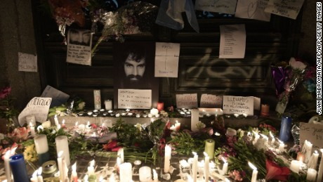 View of a makeshift altar set up at the entrance of the judicial morgue, where the corpse of Santiago Maldonado --disappeared on August 1st during a Mapuche protest in Chubut province-- remains waiting for an autopsy in Buenos Aires, on October 20, 2017. Maldonado's body was found on October 17, 2017 in a river in southern Argentina, where he was last seen when the Gendarmerie dispersed a Mapuche protest in Resistencia, Cushamen department, some 1,850 kilometres southwest of Buenos Aires. Maldonado's relatives confirmed the identity of the corpse saying ''We recognised the tattoos, we are convinced that it is Santiago''. / AFP PHOTO / JUAN MABROMATA        (Photo credit should read JUAN MABROMATA/AFP/Getty Images)