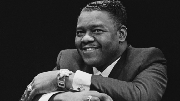 "Antoine ""Fats"" Domino, a titan of early rock 'n' roll whose piano-based hits -- such as ""Ain't That a Shame,"" ""Blueberry Hill"" and ""Blue Monday"" -- influenced artists including Paul McCartney and Randy Newman, died on October 24. He was 89."