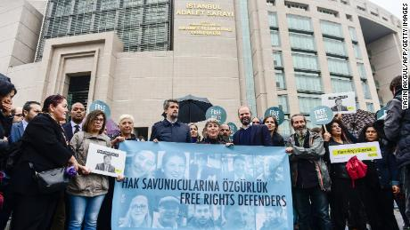 Protesters called for the release of the 11 activists outside the Istanbul courthouse on Wednesday.