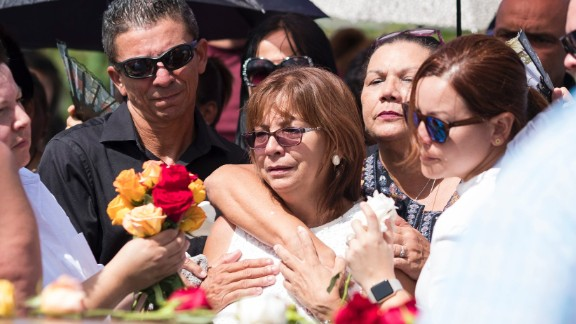October 20, 2017. Arecibo, Puerto Rico. Burial of Isabel Rivera Gonzalez one month later of Hurricane Maria hit the island. Isabel passed away in October 15 because the hospital Manati Medical Center ran out of power causing health complications. Her body was buried in the cemetery of Sabana Hoyos in Arecibo. Her daughter Evelyn Cruz Rivera in front of the coffin. (photo by: Jose Rodrigo Madera)