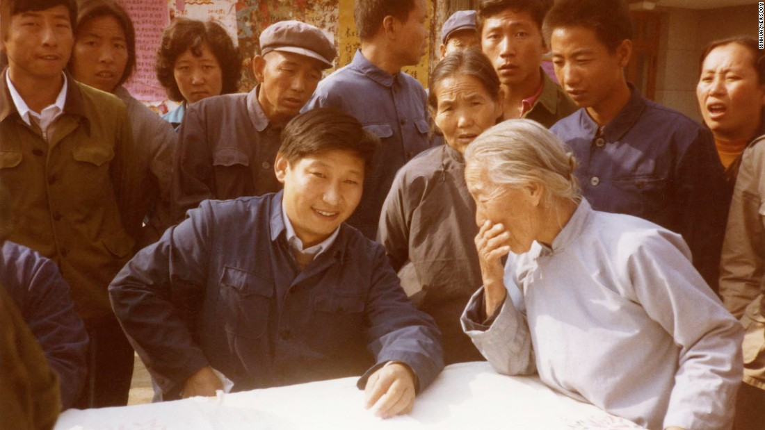 Xi listens to villagers in north China's Zhengding County in 1983. At the time, he was secretary of the Zhengding County Committee.