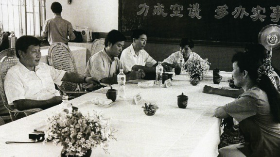 Xi, left, meets with citizens of Fuzhou, China, in 1993. He was the city's party secretary from 1990-1996.