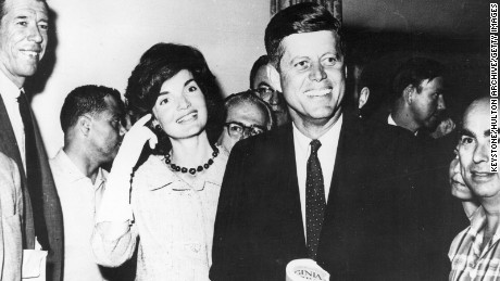 John F Kennedy (1917 - 1963), Senator for Massachusetts with his wife, Jacqueline (1929 - 1994), about to leave New York for the Los Angeles Democratic Party Convention, at which the party candidates for the forthcoming Presidential election will be nominated.    (Photo by Keystone/Getty Images)