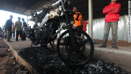 A motorcycle stands in the fireworks factory after the explosion on Thursday.