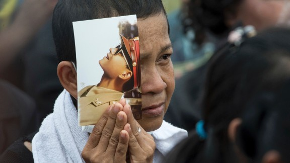 A mourner holds a portrait of King Bhumibol Adulyadej during his funeral procession and royal cremation ceremony in Bangkok.