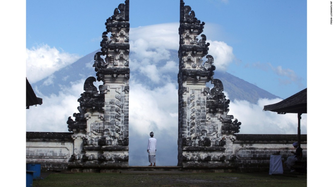 <strong>Karangasem, Bali:</strong> A man keeps an eye on the active and threatening Mount Agung volcano.