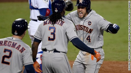 0302ddba0 George Springer of the Houston Astros celebrates with Cameron Maybin after  hitting a two-run