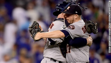 LOS ANGELES, CA - OCTOBER 25:  Brian McCann #16 celebrates with Chris Devenski #47 of the Houston Astros after defeating the Los Angeles Dodgers 7-6 in eleven innings to win game two of the 2017 World Series at Dodger Stadium on October 25, 2017 in Los Angeles, California.  (Photo by Harry How/Getty Images)