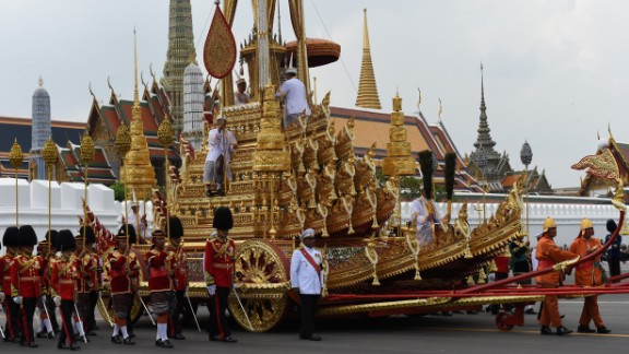 The Royal Urn is carried in the Royal Chariot during the funeral procession for the late Thai king Bhumibol Adulyadej in Bangkok on October 26, 2017. A sea of black-clad mourners massed across Bangkok's historic heart early on October 26 as funeral rituals began for King Bhumibol Adulyadej, a revered monarch whose passing after a seven-decade reign has left Thailand bereft of its only unifying figure.  / AFP PHOTO / Anthony WALLACE        (Photo credit should read ANTHONY WALLACE/AFP/Getty Images)