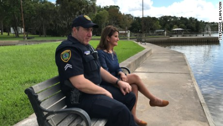 Houston Police Officer Norbert Ramón, pictured here with his wife, Cindy (right), sent her a picture of himself while in the midst of boat rescues so that she would know he was feeling fine.