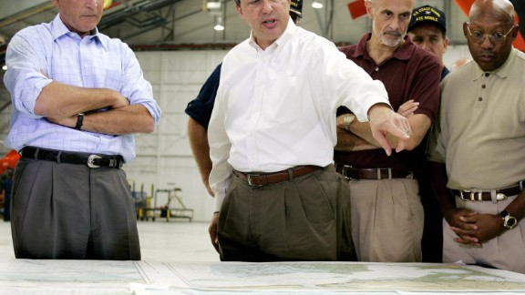 President George W. Bush getting a briefing from FEMA chief Michael Brown in Mobile, Alabama