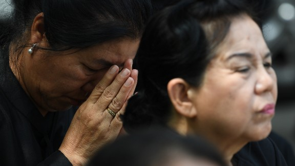 Mourners react during the funeral.