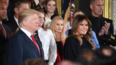 "US President Donald Trump arrives with First Lady Melania Trump to deliver remarks on combatting drug demand and the opioid crisis on October 26, 2017 in the East Room of the White House in Washington, DC. US President Donald Trump on October 26, 2017 is to declare the opioid crisis a ""nationwide public health emergency,"" stepping up the fight against an epidemic that kills more than 100 Americans every day, officials said. / AFP PHOTO / JIM WATSON        (Photo credit should read JIM WATSON/AFP/Getty Images)"