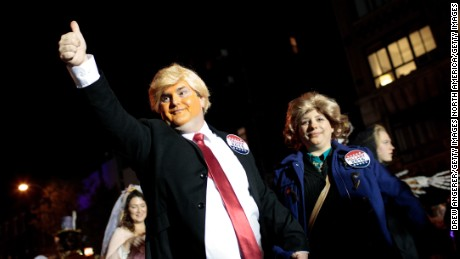 NEW YORK, NY - OCTOBER 31:  A pair dressed as Donald Trump and Hillary Clinton walk with revelers along Sixth Avenue during the 43rd annual Village Halloween Parade, October 31, 2016 in New York City. Thousands of people are expected to attend as the parade travels up Sixth Avenue through the West Village. (Photo by Drew Angerer/Getty Images)