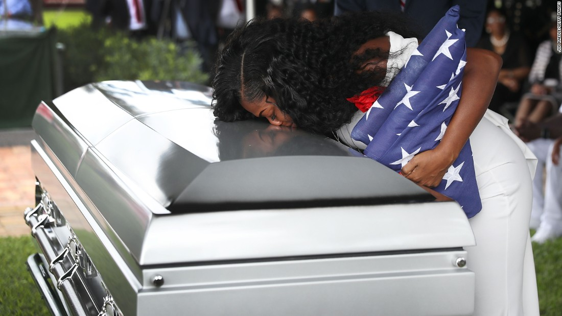 "Myeshia Johnson kisses the casket of her husband, US Army Sgt. La David Johnson, during <a href=""http://www.cnn.com/2017/10/21/us/sgt-la-david-johnson-funeral/index.html"" target=""_blank"">his burial service</a> in Hollywood, Florida, on Saturday, October 21. Sgt. Johnson and three other American soldiers were killed in an ambush in Niger on October 4."