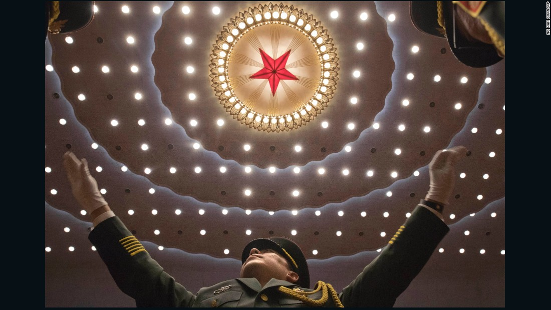 "A conductor leads a military band in Beijing's Great Hall of the People on Tuesday, October 24. It was the closing ceremony for <a href=""http://www.cnn.com/2017/10/17/asia/china-party-congress-what-you-need-to-know/index.html"" target=""_blank"">the 19th National Congress</a> of the Communist Party of China."