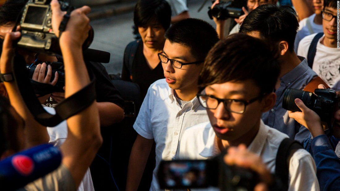 "Pro-democracy activist Joshua Wong, center, walks out of a courtroom after being released on bail on Tuesday, October 24. Wong and Nathan Law, two leaders of Hong Kong's pro-democracy movement, <a href=""http://www.cnn.com/2017/10/24/asia/hong-kong-joshua-wong-nathan-law-umbrella/index.html"" target=""_blank"">were freed by a judge</a> while they appeal their prison terms. They were jailed in August for offenses related to street protests in 2014. The demonstrations shut down parts of central Hong Kong for more than two months."