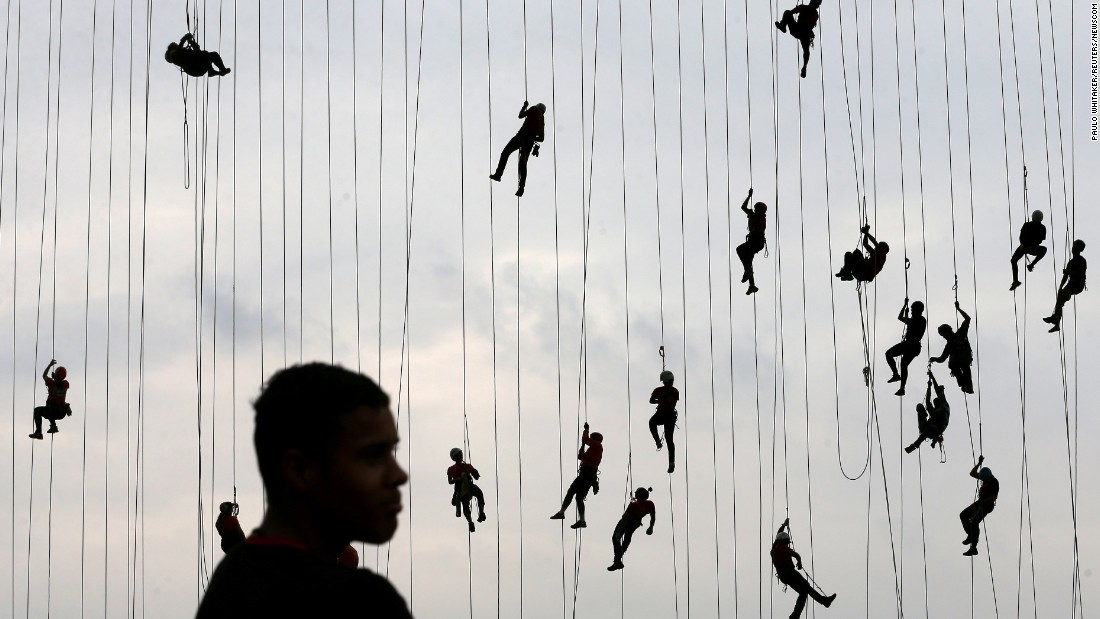 "People hang onto ropes after <a href=""https://www.theguardian.com/world/video/2017/oct/24/rope-jumpers-attempt-to-break-world-record-in-brazil-video"" target=""_blank"">jumping off a bridge together</a> in Hortolandia, Brazil, on Sunday, October 22. According to organizers, 245 people were trying to set a new world record for ""rope jumping."""