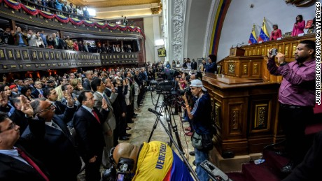 General view of the swearing in ceremony of the elected governors before the pro-government Constituent Assembly in Caracas on October 18, 2017. The Venezuelan opposition faces the risk of losing its five elected governors in the regional elections, due to their refusal to subordinate them to the ruling Constituent Assembly: a new front of conflict opens in a political crisis with no view of solution / AFP PHOTO / Juan BARRETOJUAN BARRETO/AFP/Getty Images