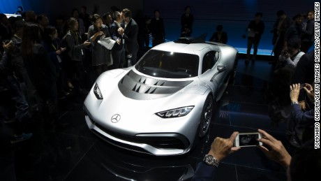 TOKYO, JAPAN - OCTOBER 25:  Visitors look at Mercedes-Benz AG's Mercedes-AMG Project ONE coupe during the Tokyo Motor Show at Tokyo Big Sight on October 25, 2017 in Tokyo, Japan. The 45th edition of Tokyo Motor Show, which domestic and international automobile manufacturers exhibit their latest products, continues until November 5.  (Photo by Tomohiro Ohsumi/Getty Images)