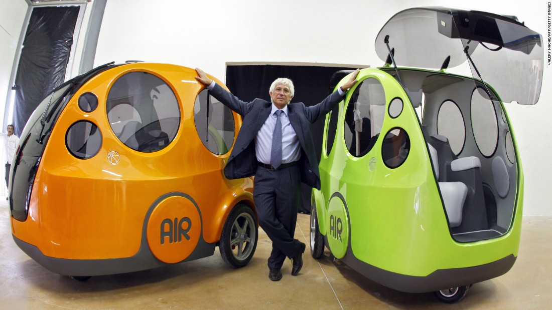 These AIRPod One prototypes are powered by compressed air, driven by joystick, and can be refilled like a gasoline car at compressed air stations. <br /><br />Plans for the AIRPod, created by Guy Negre (pictured) head of MDI, have been in the works for two decades, and it is expected to be on the market later this year.