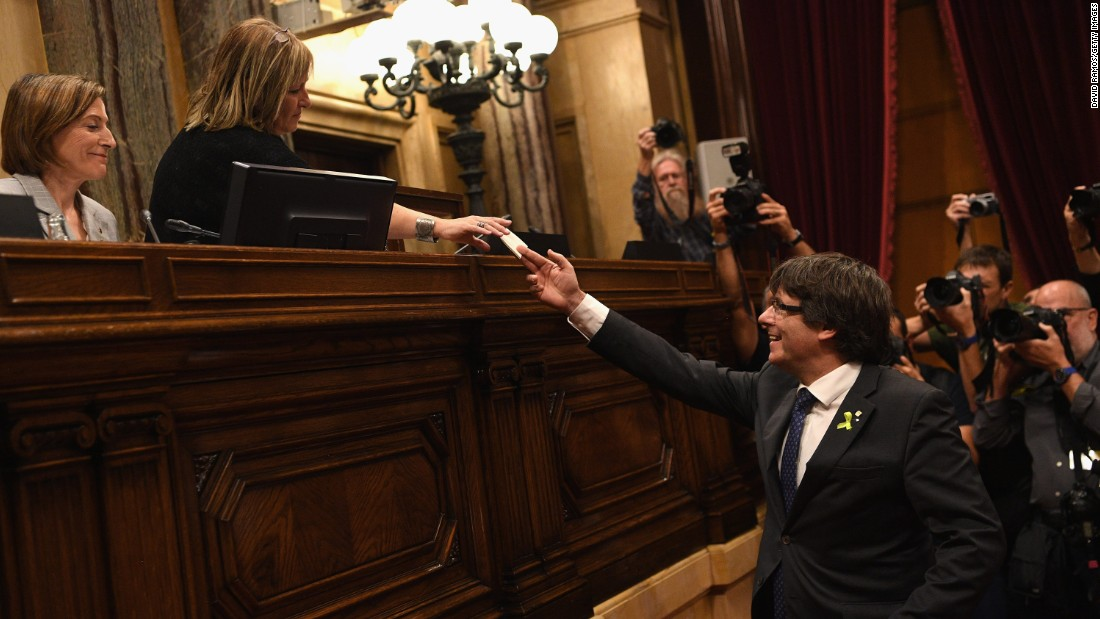 Catalan President Carles Puigdemont casts his vote for independence from Spain at the Generalitat de Catalunya on October 27, 2017, in Barcelona, Spain. Members of the Catalan Parliament voted for independence following a two-day session on how to respond the Spanish government's enacting of Article 155, which would curtail Catalan autonomy.