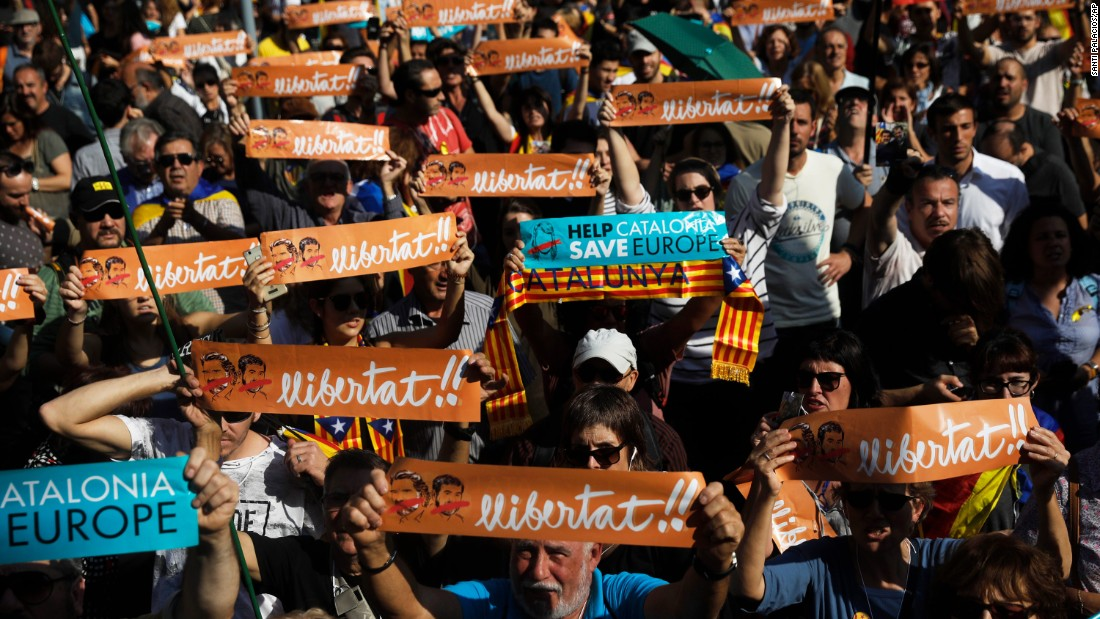 Protesters holds banners that read ''freedom'' in Catalan and include portraits of Jordi Sanchez and Jordi Cuixart, the imprisoned leaders of two Catalan grassroots organizations, during a rally outside the Catalan Parliament in Barcelona.