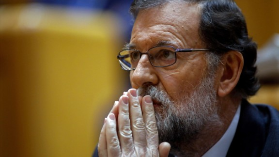 Spain's Prime Minister Mariano Rajoy attends a session of the Upper House of Parliament in Madrid on October 27, 2017. Spanish Prime Minister Mariano Rajoy asked the Senate for the go-ahead to depose Catalan leader Carles Puigdemont and his executive in a bid to stop their independence drive. The central government has invoked the never-before-used article 155 of the Constitution, designed to rein in rebel regions, as it seeks to end Catalonia's drive to break from Spain.