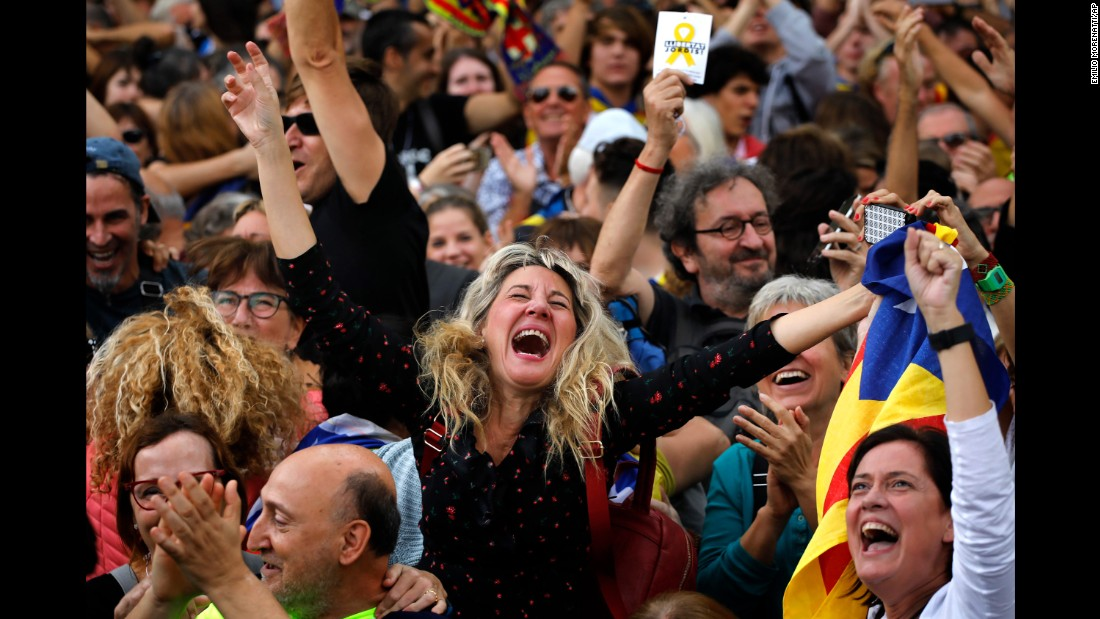 Maria Salut, 50, center, celebrates the unilateral declaration of independence of Catalonia outside the Catalan Parliament, in Barcelona, Spain.